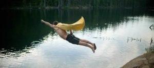 Full length of man dressed as superhero jumping in Brohm lake